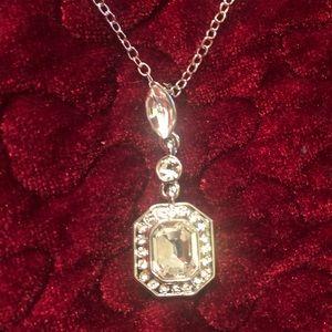 Carolee emerald cut crystal pendant necklace